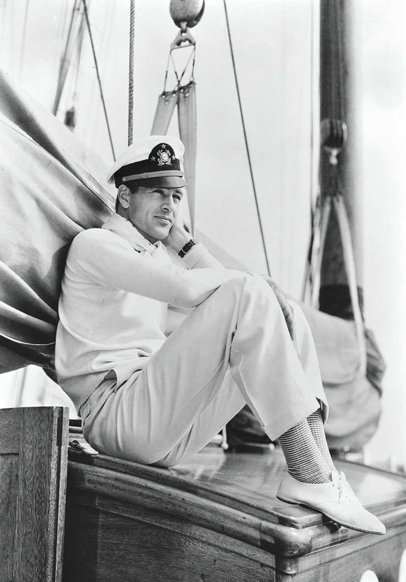 circa 1940: American actor Gary Cooper (1901 - 1961) sitting on board a yacht wearing a sailor